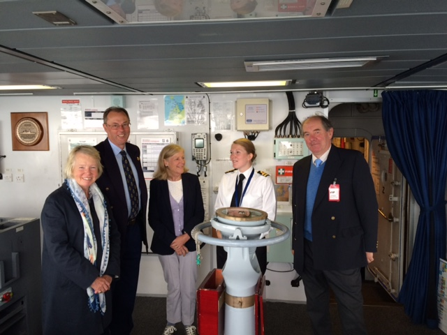 High Sheriff and friends getting a briefing on the bridge of HMS Dauntless.